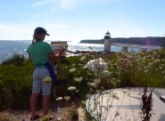 student-painting-at-marshall-point-lighthouse